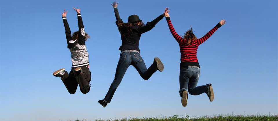 Three people jumping in celebration